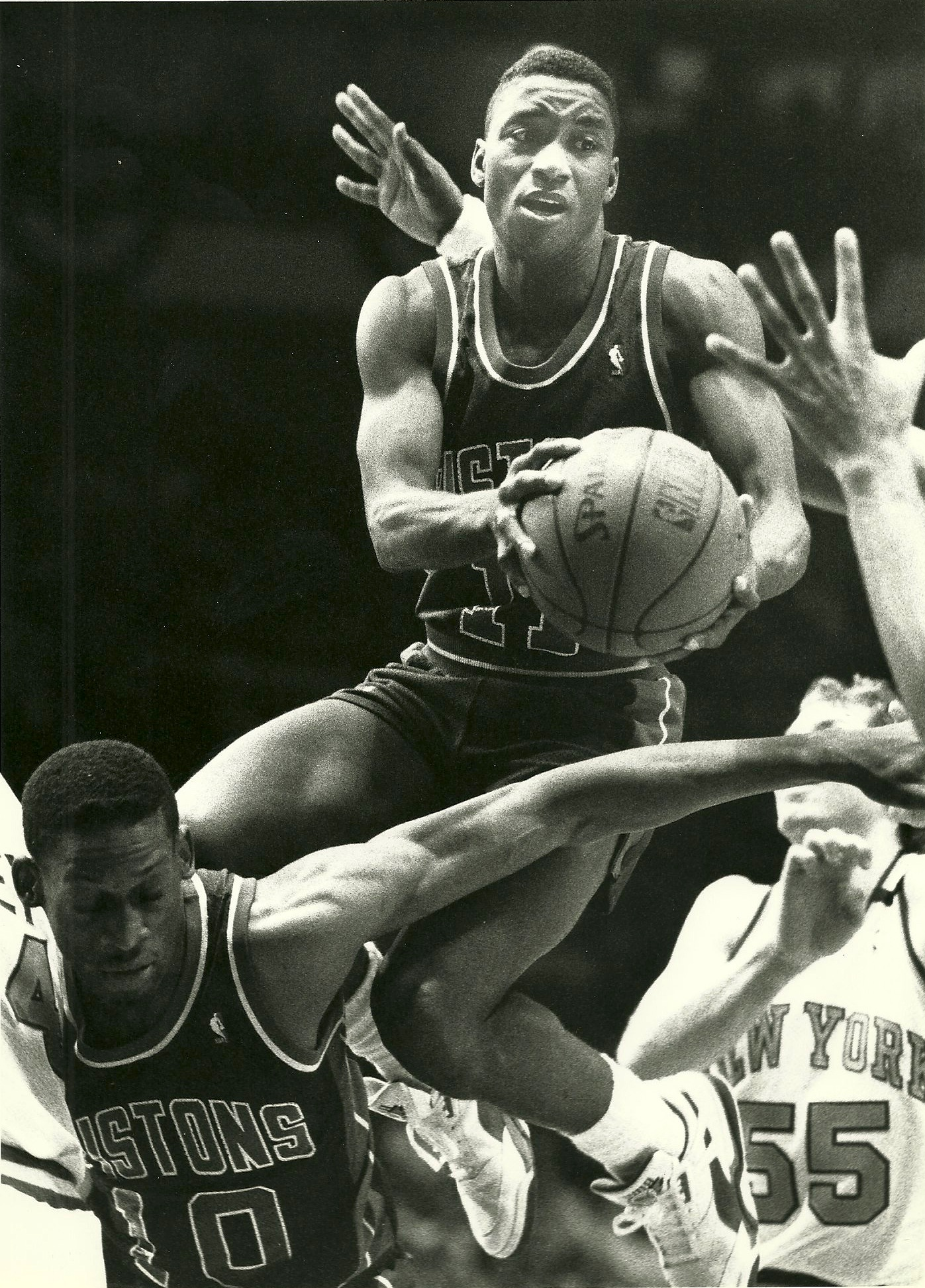 Isaiah Thomas looks to pass while taking a ride on Dennis Rodman's back. Photo copyright Chris S. Cornell.